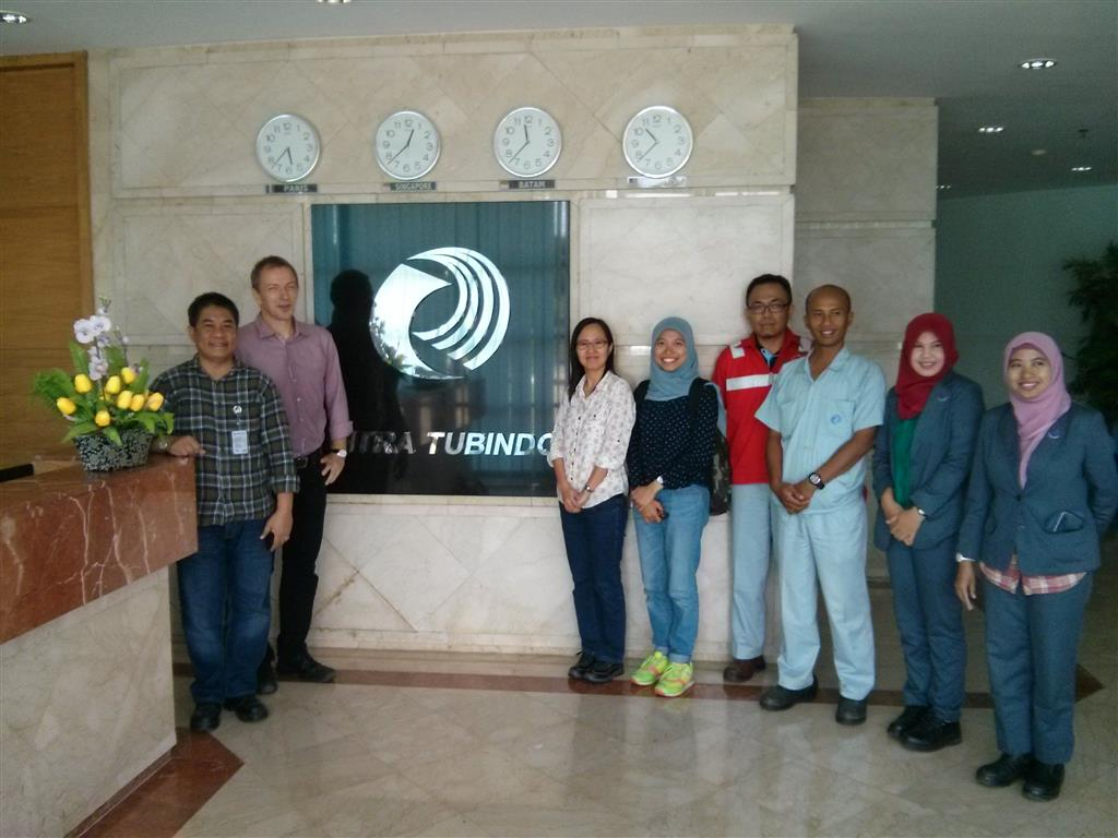 RECP team took a photo with one of the demonstration companies team in front of the company logo after had a plant tour and discussion.