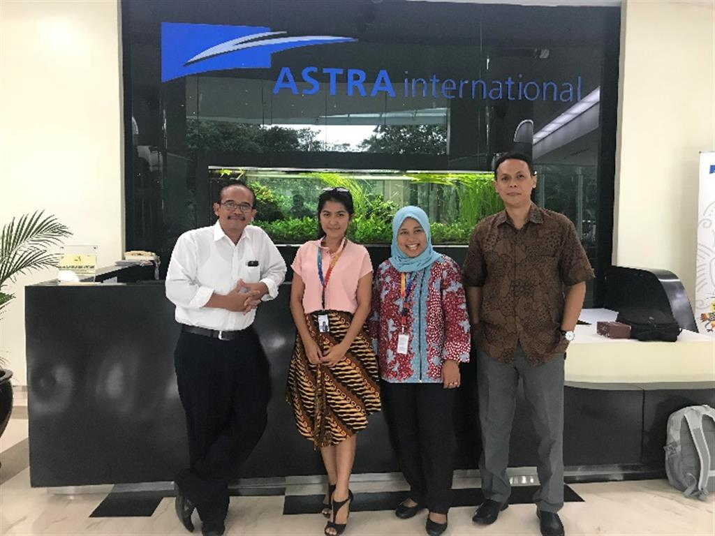 Team of AGC assessor pictured together in Astra's office mail lobby.